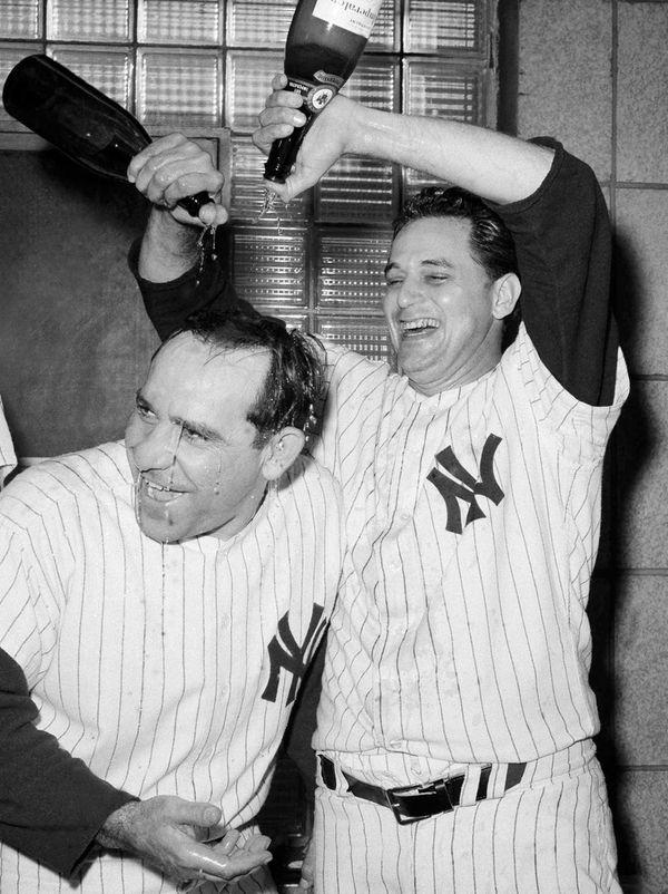 New York Yankees manager Yogi Berra, left, gets