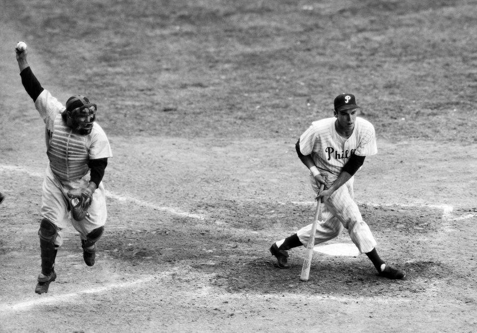 New York Yankees catcher Yogi Berra holds the