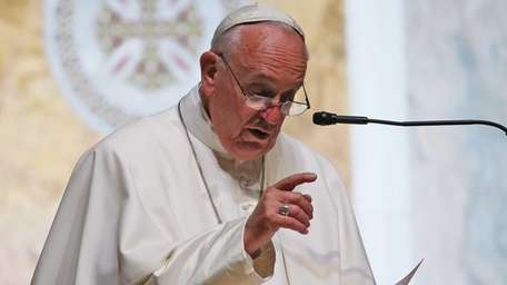 Pope Francis speaks to bishops during the midday