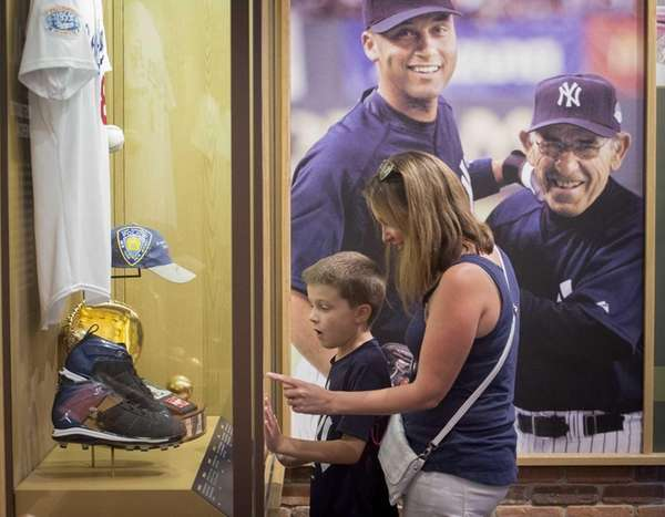 Yankees fan Melanie Schowalter and her son Hudson,