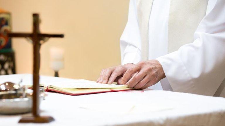 Priest at an altar.