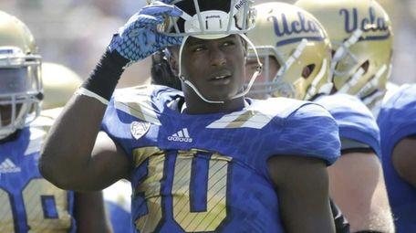 UCLA linebacker Myles Jack, center, looks away during