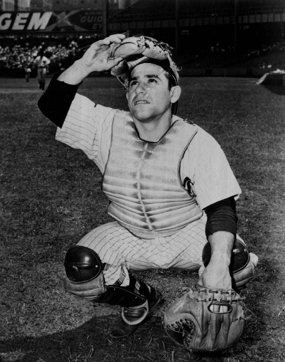 Yogi Berra of the New York Yankees poses