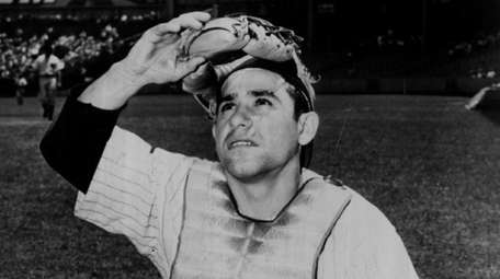Yogi Berra of the New York Yankees poses