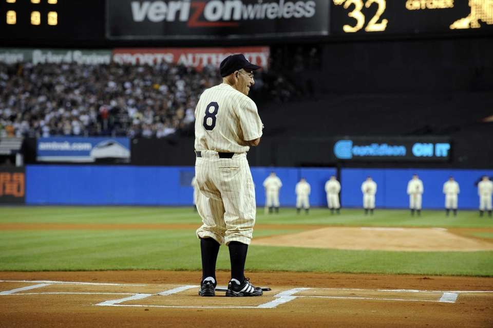 Yogi Berra stands at home plate before the