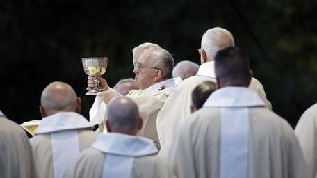 Pope Francis conducts Mass outside the Basilica of