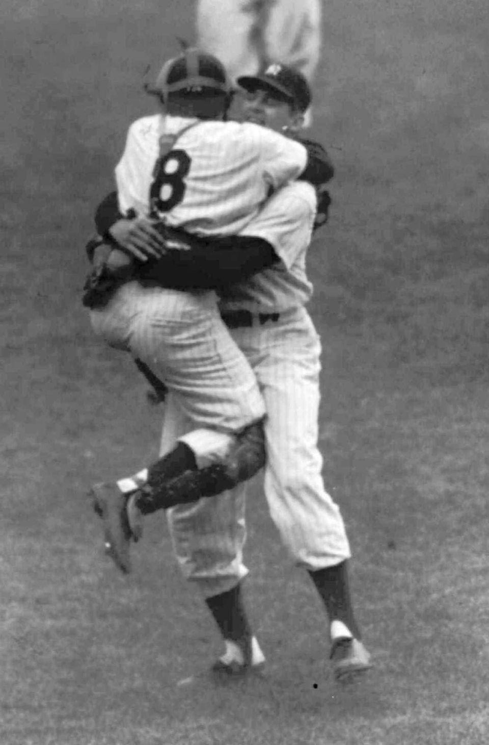 New York Yankees catcher Yogi Berra leaps into
