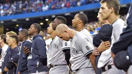 New York Yankees players, coaches and staff take