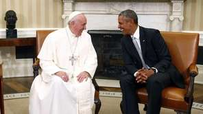 President Barack Obama talks with Pope Francis in