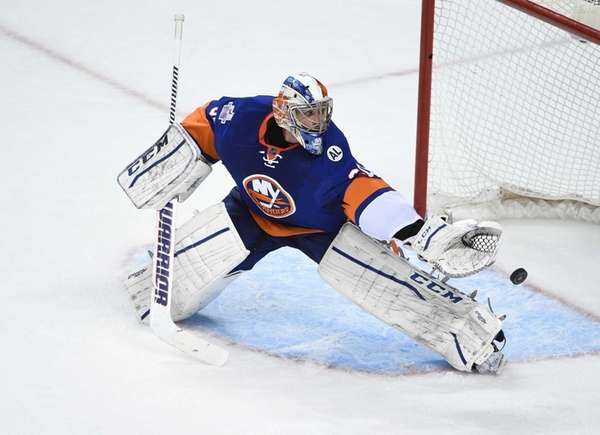 New York Islanders goalie Kevin Poulin makes a