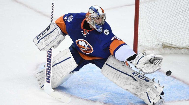 New York Islanders goalie Kevin Poulin makes a