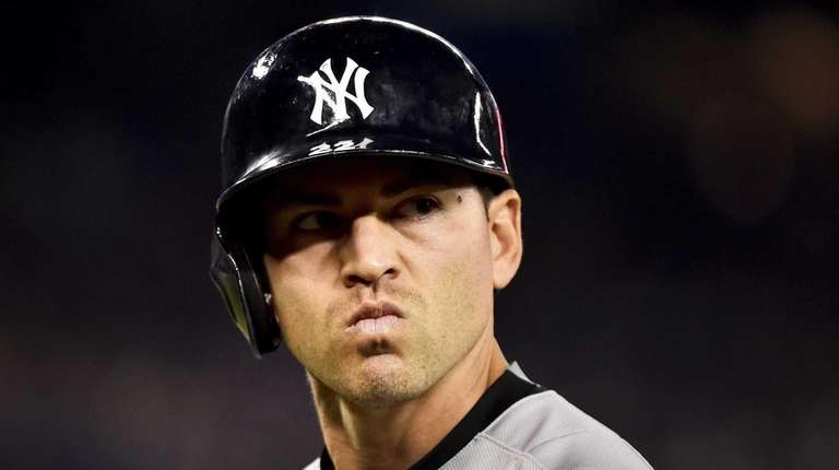 The New York Yankees' Jacoby Ellsbury reacts after