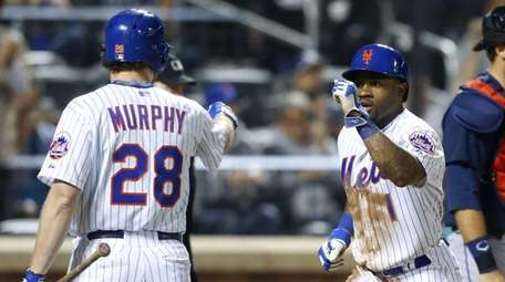 Pinch-runner Eric Young Jr. #1 of the New