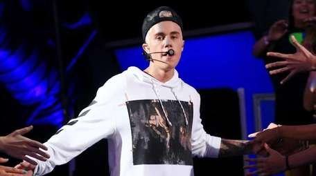 Justin Bieber performs during the Think It Up