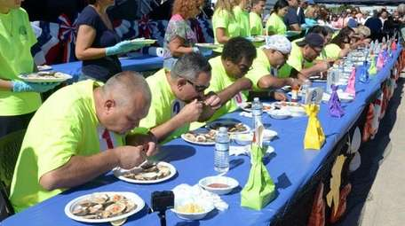 Competitors try to win a past clam-eating contest