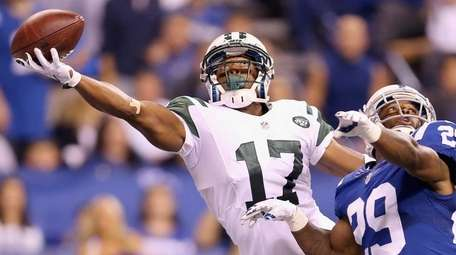 Chris Owusu of the New York Jets reaches
