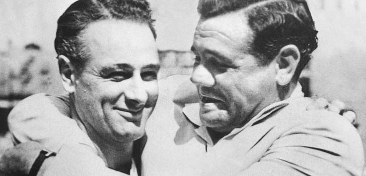 Babe Ruth, right, hugs Lou Gehrig during an