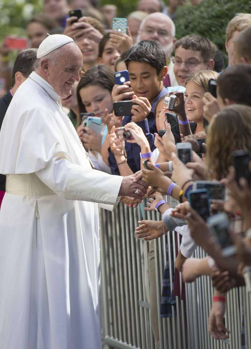 Pope Francis greets well-wishers at the Apostolic Nunciature