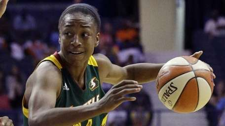 Seattle Storm guard Jewell Loyd, right, drives as