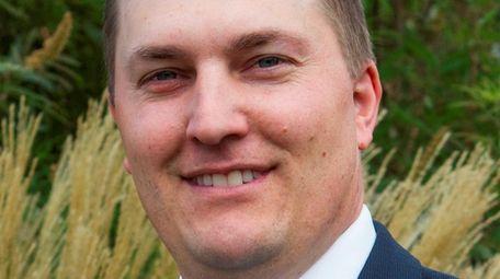 Michael Breunig of Sayville has been made partner