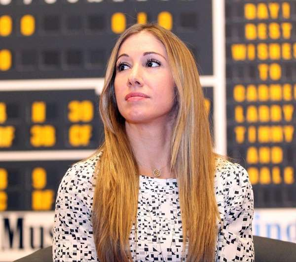 Yogi Berra's granddaugther, Lindsay Berra, speaks at a