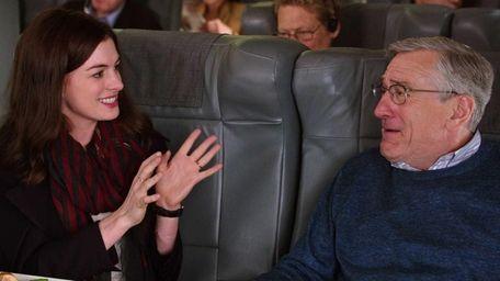Anne Hathaway and Robert De Niro as Ben