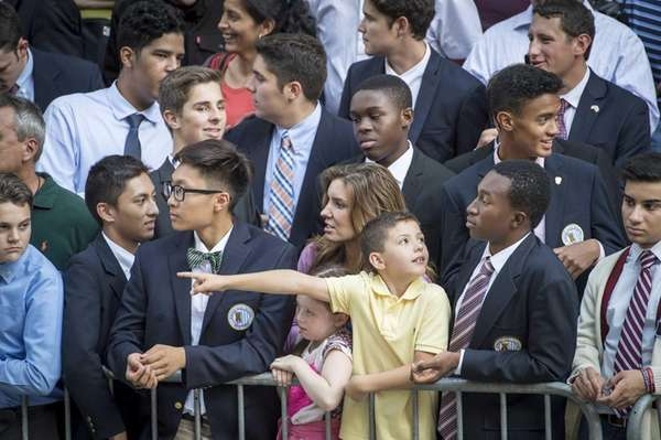 Students await Pope Francis' motorcade outside St. Patrick's