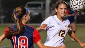 Massapequa's Julia Ophals, right, plays the ball against