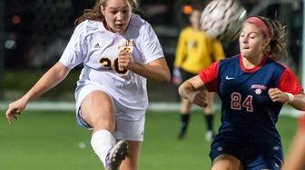 Massapequa's Mikayla Pugliese, left, plays the ball against
