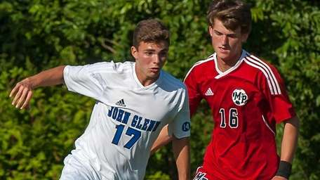 Glenn's Luke Karen, left, dribbles the ball against