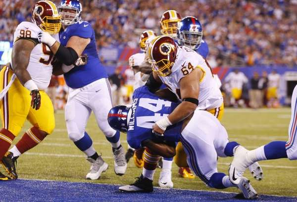 Andre Williams of the New York Giants carries