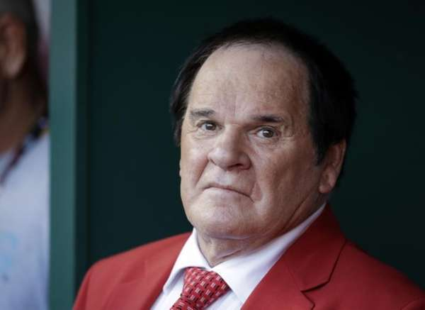 Pete Rose waits to be introduced before the