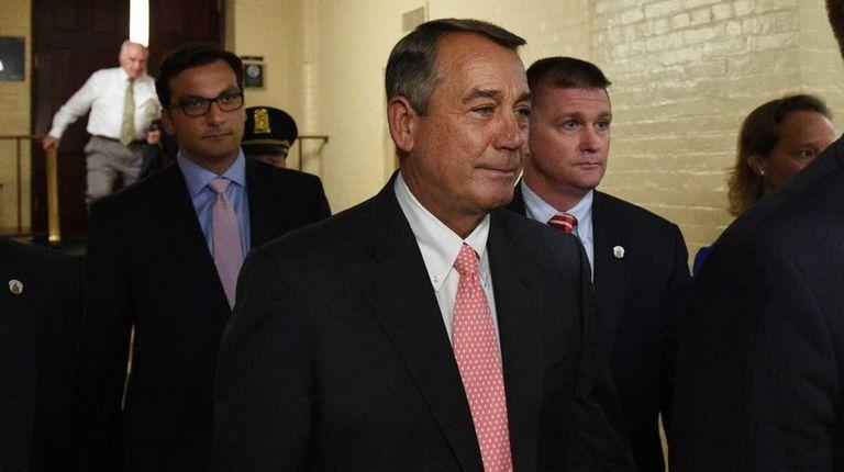 Speaker of the House John Boehner leaves after