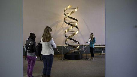 A floor-to-ceiling replica of Nobel laureates James Watson