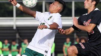 Westbury's Jonathan Guardado heads the ball during a