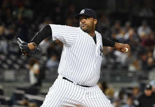 New York Yankees starting pitcher CC Sabathia delivers