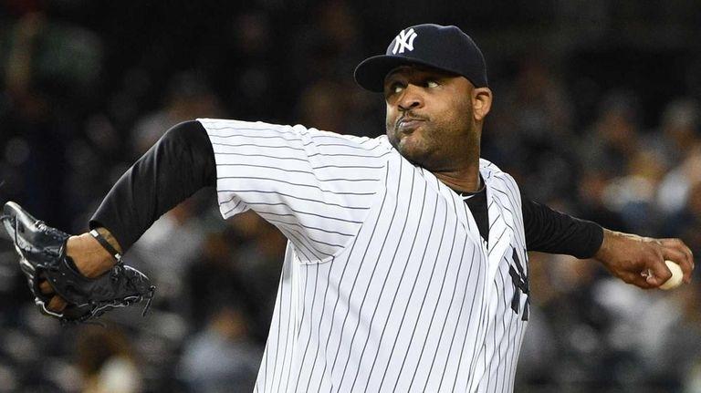 New York Yankees starting pitcher CC Sabathia delivers