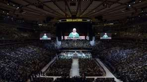 A general view shows thousands of faithful attending