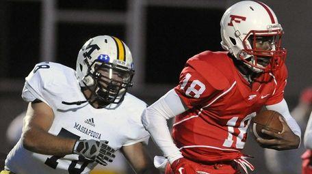Freeport quarterback Rashad Tucker. right, scrambles for yards