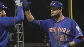 New York Mets Lucas Duda gets congratulated by