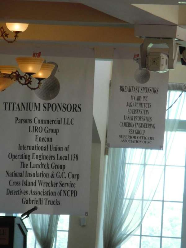 Sponsor signs on display at the Hicksville Republican