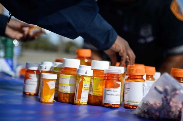 Suffolk County police officers collect prescription drugs as