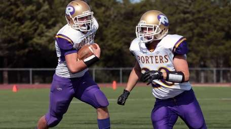 Greenport's Keegan Syron #7 follows his lead blocker