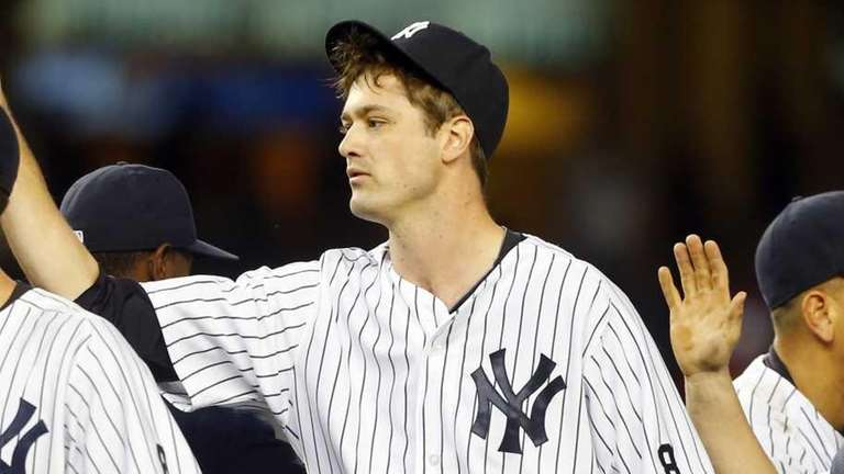 Greg Bird #31, Andrew Miller #48 and Brian