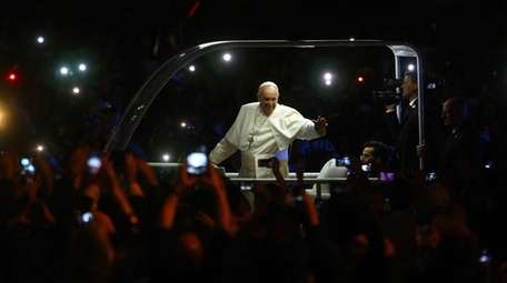 Pope Francis makes his way to the Festival