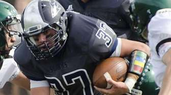 Eastport-South Manor's Nick Garone tries to get past