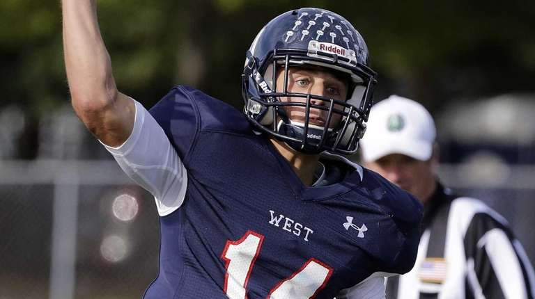 Smithtown West's quarterback Daniel J. Caroussos throws from