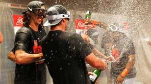 Members of the New York Mets celebrate with