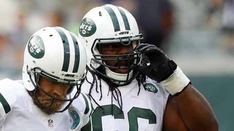 Ryan Fitzpatrick #14 and Willie Colon #66 of