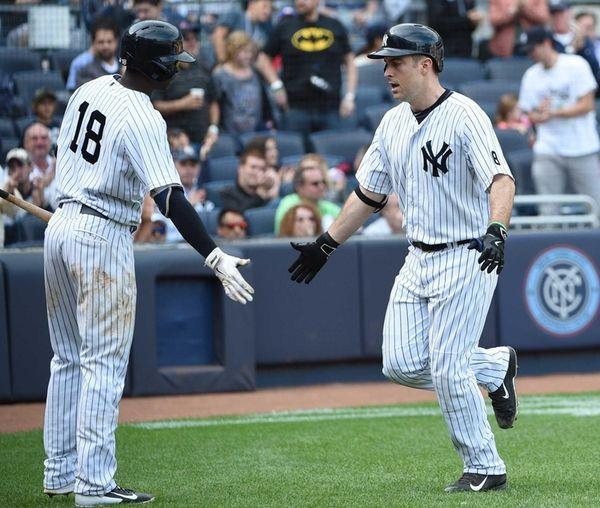 New York Yankees shortstop Didi Gregorius congratulates New